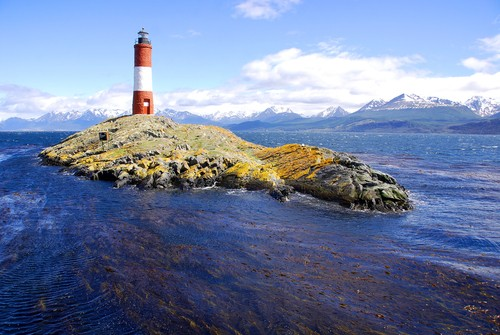 Red and white lighthouse in blue sky in the Beagle Channel Ushuaia Patagonia Argentina