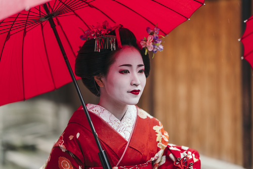Maiko,Geisha,Walking,On,A,Street,Of,Gion,In,Kyoto